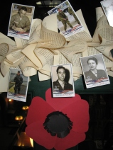 Veteran photos on book page garland with poppy